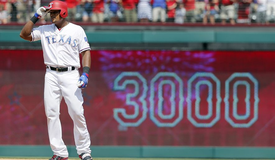 FILE- In this July 30, 2017, file photo, Texas Rangers' Adrian Beltre tips his helmet as he acknowledges cheers after hitting a double for his 3,000th career hit, that came off a pitch from Baltimore Orioles' Wade Miley in the fourth inning of a baseball game, in Arlington, Texas. Beltre is signed through 2018, and wants his 21st MLB season to be with the Rangers. The newest member of the 3,000-hit club also wants another chance to win a World Series. (AP Photo/Tony Gutierrez, File)
