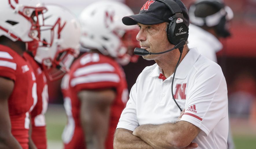 FILE - In this Saturday, Sept. 23, 2017, file photo, Nebraska head coach Mike Riley follows the second half of an NCAA college football game against Rutgers in Lincoln, Neb. Nebraska faces back-to-back games against top-10 opponents in Wisconsin and Ohio State and then a tricky road game at Purdue. The three games could go a long way in determining how the season and coach Riley are judged. (AP Photo/Nati Harnik, File)