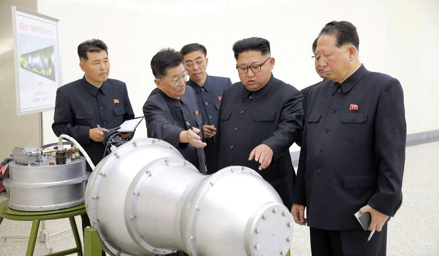 This undated file photo distributed on Sept. 3, 2017, by the North Korean government shows North Korean leader Kim Jong-un (second from right) at an undisclosed location in North Korea. (Korean Central News Agency/Korea News Service via AP) **FILE**