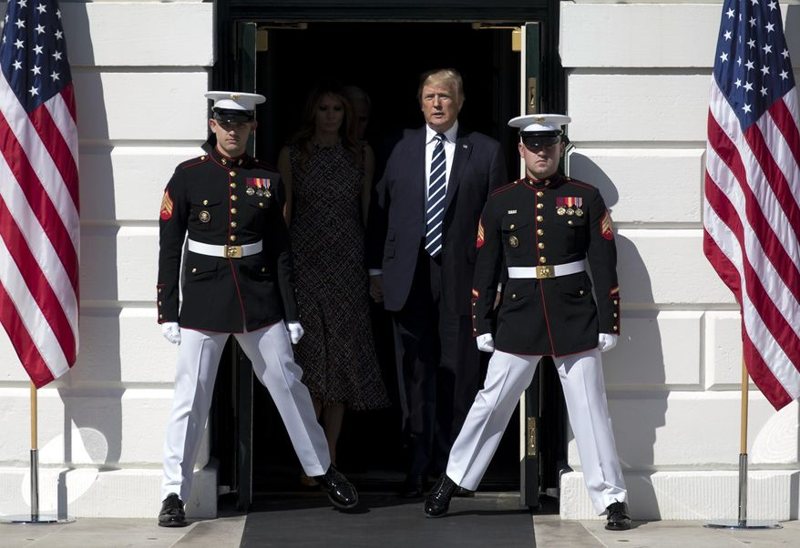 President Donald Trump and first lady Melania Trump walk from the White House in Washington, Monday, Oct. 2, 2017, to the South Lawn for a moment of silence to remember the victims of the mass shooting in Las Vegas. (AP Photo/Carolyn Kaster)