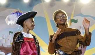 """This image released by ABC shows Miles Brown, left, and Marsai Martin in a scene from the season four premiere episode of """"black-ish,"""" premiering Tuesday, Oct. 3. (Kelsey McNeal/ABC via AP)"""