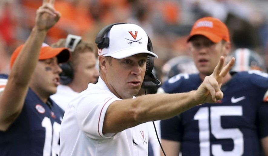 FILE - In this Sept. 3, 2016, file photo, Virginia head coach Bronco Mendenhall calls for a two-point conversion during the second half of an NCAA football game against Richmond in Charlottesville, Va. With a 3-1 record and coming off a bye week, Virginia turns its attention to recent nemesis Duke. (AP Photo/Andrew Shurtleff, File) **FILE**