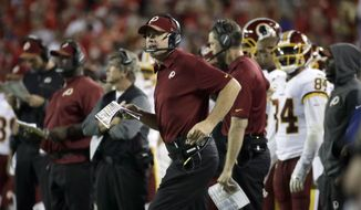 Washington Redskins head coach Jay Gruden follows the second half of an NFL football game against the Kansas City Chiefs in Kansas City, Mo., Monday, Oct. 2, 2017. (AP Photo/Charlie Riedel)