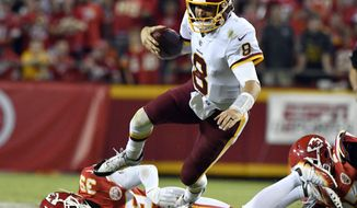 Washington Redskins quarterback Kirk Cousins (8) is tackled by Kansas City Chiefs defensive back Terrance Mitchell (39) during the second half of an NFL football game in Kansas City, Mo., Monday, Oct. 2, 2017. The Chiefs won 29-20. (AP Photo/Ed Zurga)