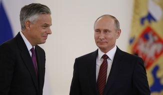 U.S. Ambassador Jon Huntsman (left) walks after presenting credentials to Russian President Vladimir Putin (right) during a ceremony in the Kremlin in Moscow on Oct. 3, 2017. The new U.S. Ambassador to Russia presented his credentials to President Vladimir Putin in the Kremlin on Monday amid investigations into Moscow's meddling in the 2016 U.S. elections. (Associated Press) **FILE**