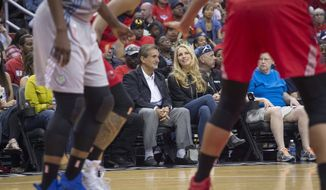 In this image taken Sept. 17, 20, 2017, and provided by Monumental Sports & Entertainment, Ted Leonsis, left, chairman and CEO of Monumental Sports & Entertainment, sits with billionaire executive Laurene Powell Jobs during a basketball game in Washington, D.C. Powell Jobs has agreed to buy a 20 percent stake in Ted Leonsis' Monumental Sports & Entertainment., pending approval from the NBA and NHL. Monumental owns the Washington Wizards, Capitals, Mystics and the Arena Football League's Washington Valor and Baltimore Brigade. (Barbara Kinney/Monumental Sports & Entertainment via AP) **FILE**