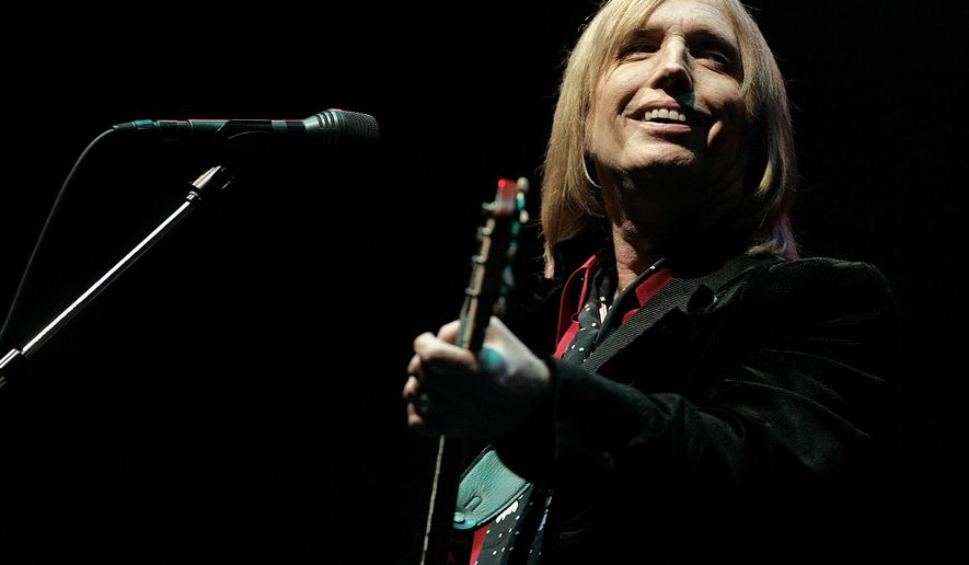 In this June 16, 2006 file photo, Tom Petty performs at the Bonnaroo Music & Arts Festival in Manchester, Tenn. Petty has died at age 66. (AP Photo/Mark Humphrey, File)