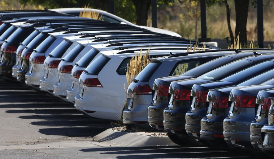 In this Thursday, Sept. 24, 2015, photo, Volkswagen cars for sale are on display on the lot of a dealership in Boulder, Colo. Volkswagen is one of four companies reportedly under an antitrust investigation by the Dept. of Justice for colluding with other automakers to abide by stricter California emissions standards rather than lower ones set by the federal government. (AP Photo/Brennan Linsley) **FILE**