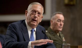 Defense Secretary Jim Mattis, left, accompanied by Joint Chiefs Chairman Gen. Joseph Dunford, speaks on Afghanistan before the Senate Armed Services Committee on Capitol Hill in Washington, Tuesday, Oct. 3, 2017. (AP Photo/Andrew Harnik) ** FILE **
