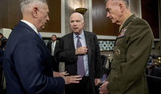 Defense Secretary Jim Mattis, left, and Joint Chiefs Chairman Gen. Joseph Dunford, right, speak with Chairman Sen. John McCain, R-Ariz., center, as they arrive to testify on Afghanistan before the Senate Armed Services Committee on Capitol Hill in Washington, Tuesday, Oct. 3, 2017. (AP Photo/Andrew Harnik)