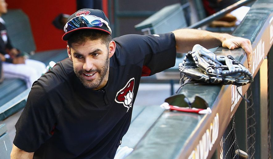 Arizona Diamondbacks right fielder J.D. Martinez smiles as he talks with another player during practice Monday, Oct. 2, 2017, at Chase Field for a National League wild-card playoff baseball game in Phoenix. The Diamondbacks face the Colorado Rockies on Wednesday. (AP Photo/Ross D. Franklin)