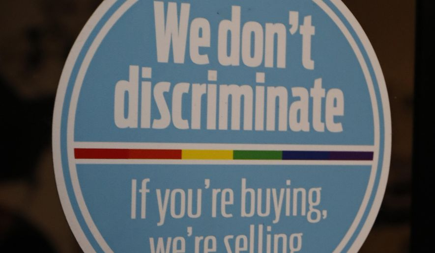 This nondiscrimination sticker is in the window of Steve's, a downtown Jackson, Miss., restaurant, Monday, Oct. 2, 2017. Owners Steve Long and his wife are among a number of business owners who practice nondiscrimination with their clientele. But a Mississippi law that lets government workers and business people cite their own religious objections to refuse services to gay couples, is set to go into effect Friday because a federal appeals court refused to keep blocking it. Advocates of same-sex marriage said Monday, that they will ask the U.S. Supreme Court to strike it down. (AP Photo/Rogelio V. Solis)