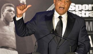 FILE - In this Oct. 1, 2015, file photo, former heavyweight boxing champion George Foreman tells a story of a young Muhammad Ali to the audience at the Sports Illustrated Legacy Awards Thursday, in Louisville, Ky. Foreman took to Twitter on Oct. 3, 2017 to challenge actor Steven Seagal to a 10-round fight. Seagal declined comment. (AP Photo/Timothy D. Easley, File)