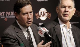 San Francisco Giants general manager Bobby Evans, left, speaks next to manager Bruce Bochy at a news conference in San Francisco, Tuesday, Oct. 3, 2017. (AP Photo/Jeff Chiu)