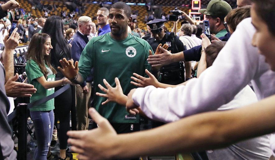 Boston Celtics guard Kyrie Irving is greeted by fans after the teams NBA preseason basketball game against the Charlotte Hornets in Boston, Monday, Oct. 2, 2017. The Celtics defeated the Hornets 94-82. (AP Photo/Charles Krupa)