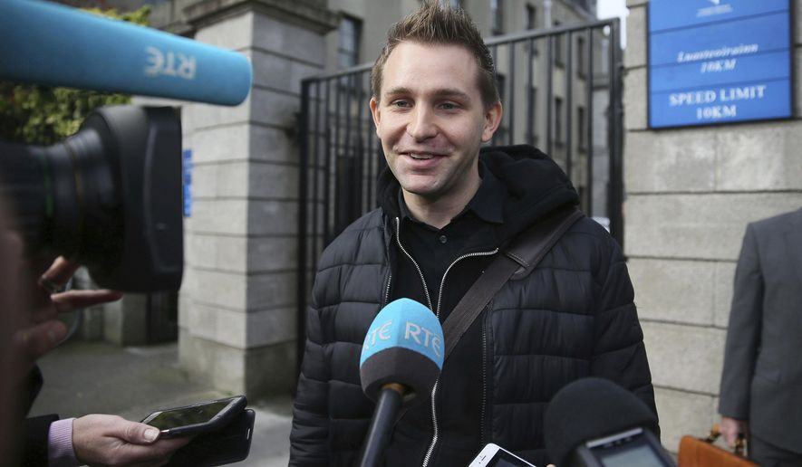 Max Schrems, front right, faces the media after leaving the High Court in Dublin, Ireland, Tuesday Oct. 3, 2017, as the legal case about social media transfer of personal data between international jurisdictions has been referred to Europe's highest court.  Austrian lawyer and campaigner Max Schrems claims his privacy rights as an EU citizen have been breached through the transfer of his data by Facebook Ireland to US parent company Facebook Inc. (Brian Lawless/PA via AP)