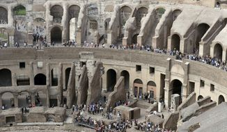 Tourists are seen visiting the ancient Colosseum as seen from the topmost floor on the occasion of a media tour presenting the re-opening after forty years of the fourth and fifth level of the Italy's most famous site, in Rome, Tuesday, Oct. 3, 2017. Italian Culture Minister Dario Francheschini was on hand Tuesday to tour the new levels, which during ancient Roman times were the cheapest seats, reserved for the plebes because they were farther away from the spectacle and exposed to Rome's harsh sun.  (AP Photo/Andrew Medichini)