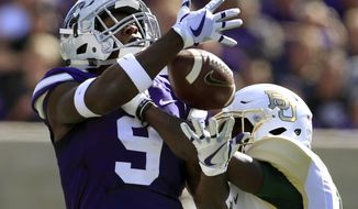 FILE - In this Saturday, Sept. 30, 2017, file photo, Baylor cornerback Jameson Houston, right, breaks up a pass intended for Kansas State wide receiver Byron Pringle (9) during the first half of an NCAA college football game in Manhattan, Kan. Five times. That's how many times Kansas State threw the ball in the second half against Baylor. Part of it was due to the score, but part of it was also due to ongoing trouble in the Wildcats passing game (AP Photo/Orlin Wagner, File)