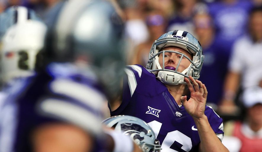 FILE - In this Saturday, Sept. 30, 2017, file photo, Kansas State quarterback Jesse Ertz passes down field during the first half of an NCAA college football game against Baylor in Manhattan, Kan. Five times. That's how many times Kansas State threw the ball in the second half against Baylor. Part of it was due to the score, but part of it was also due to ongoing trouble in the Wildcats passing game. (AP Photo/Orlin Wagner, File)