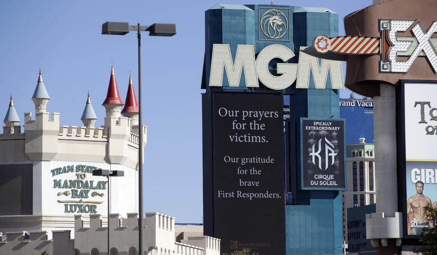 A sign asking for prayers is displayed at the MGM hotel on Tuesday, Oct. 3, 2017, in Las Vegas. A gunman opened fire on an outdoor music concert on Sunday killing dozens and injuring hundreds. (AP Photo/Chris Carlson)