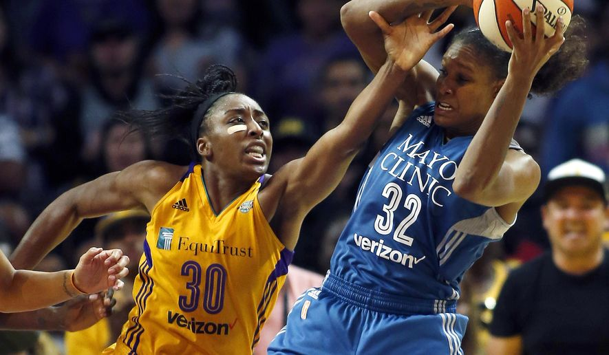 Minnesota Lynx forward Rebekkah Brunson, right, pulls down a rebound against Los Angeles Sparks forward Nneka Ogwumike during the second half in Game 4 of the WNBA basketball finals, Sunday, Oct. 1, 2017, in Los Angeles. The Lynx won 80-69. (AP Photo/Alex Gallardo)