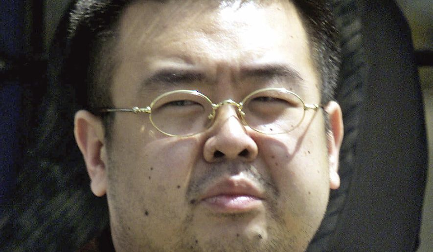 FILE - This May 4, 2001, file photo shows Kim Jong Nam, exiled half brother of North Korea's leader Kim Jong Un, in Narita, Japan. The trial of two women accused of poisoning the estranged half brother of North Korea's ruler is scheduled to begin Monday, Oct. 2, 2017, in Malaysia's High Court, nearly eight months after the brazen airport assassination. Siti Aisyah of Indonesia and Doan Thi Huong of Vietnam are suspected of smearing Kim Jong Nam's face with the banned VX nerve agent on Feb. 13 at a crowded airport terminal in Kuala Lumpur, killing him within about 20 minutes. The women say they thought they were playing a harmless prank for a hidden-camera show.(AP Photo/Shizuo Kambayashi, File)