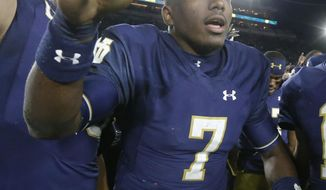 Notre Dame's Brandon Wimbush celebrates his team's 52-17 win over Miami (Ohio) after an NCAA college football game Saturday, Sept. 30, 2017, in South Bend, Ind. (AP Photo/Charles Rex Arbogast)