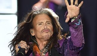 """FILE - In this May 26, 2017, file photo, singer Steven Tyler performs during an Aerosmith concert at the Koenigsplatz in Munich, Germany. In a statement posted to the band's website on Oct. 2, 2017, Tyler refuted rumors about his health surrounding an early end to the band's tour, saying he """"certainly did not have a heart attack or seizure."""" (AP Photo/Lukas Barth, File)"""