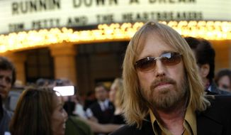 "In this Oct. 2, 2007 file photo, singer Tom Petty arrives at the world premiere of the documentary ""Runnin' Down a Dream: Tom Petty and the Heartbreakers"" in Burbank, Calif. Petty has died at age 66. Spokeswoman Carla Sacks says Petty died Monday night, Oct. 2, 2017, at UCLA Medical Center in Los Angeles after he suffered cardiac arrest. (AP Photo/Chris Pizzello, File)"