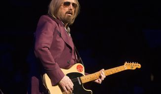 """FILE - In this July 1, 2017 file photo, Tom Petty of Tom Petty and the Heartbreakers performs during their """"40th Anniversary Tour"""" in Philadelphia. Petty has died at age 66. Spokeswoman Carla Sacks says Petty died Monday night, Oct. 2, 2017, at UCLA Medical Center in Los Angeles after he suffered cardiac arrest. (Photo by Owen Sweeney/Invision/AP, File)"""