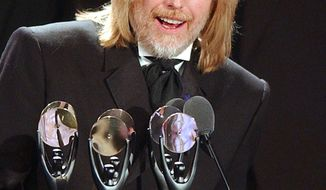 FILE - In this March 18, 2002 file photo, Tom Petty, of the band Tom Petty and the Heart Breakers, speaks after being inducted at the Rock and Roll Hall of Fame induction ceremony in New York. Petty has died at age 66. Spokeswoman Carla Sacks says Petty died Monday night, Oct. 2, 2017, at UCLA Medical Center in Los Angeles after he suffered cardiac arrest. (AP Photo/Kathy Willens, File)