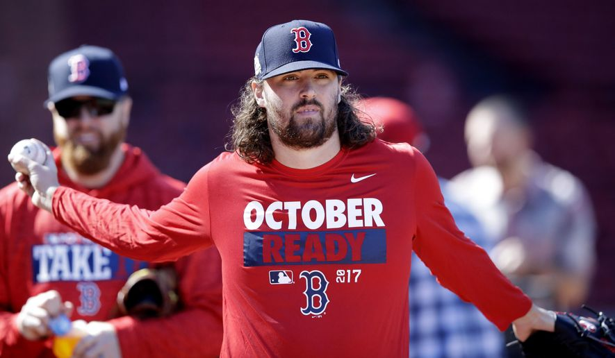 Boston Red Sox relief pitcher Heath Hembree stretches out as he heads to the outfield during baseball practice at Fenway Park in Boston, Tuesday, Oct. 3, 2017. The Red Sox face the Houston Astros in the American League Division playoff series. (AP Photo/Charles Krupa)