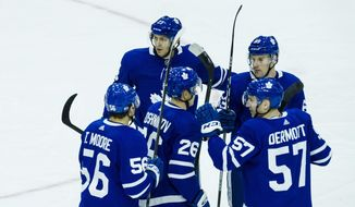 Toronto Maple Leafs players celebrate after Maple Leafs right wing Eric Fehr (23) scored during the first period of a preseason NHL hockey game against the Detroit Red Wings, Saturday, Sept. 30, 2017 in Toronto. (Christopher Katsarov/The Canadian Press via AP)