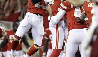 Kansas City Chiefs players celebrate with kicker Harrison Butker (7) after he kicked the go-ahead field goal late in the fourth quarter of an NFL football game against the Washington Redskins in Kansas City, Mo., Monday, Oct. 2, 2017. The Chiefs won 29-20. (AP Photo/Charlie Riedel)