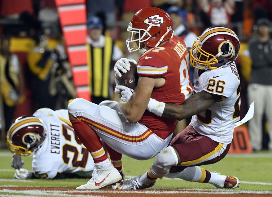 Kansas City Chiefs tight end Travis Kelce (87) makes a touchdown catch as Washington Redskins cornerback Bashaud Breeland (26) defends during the first half of an NFL football game in Kansas City, Mo., Monday, Oct. 2, 2017. (AP Photo/Ed Zurga)
