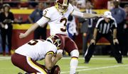 Washington Redskins' Dustin Hopkins (3) kicks a field goal from the hold of Tress Way (5) during the first half of an NFL football game against the Kansas City Chiefs in Kansas City, Mo., Monday, Oct. 2, 2017. (AP Photo/Charlie Riedel)