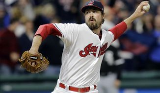 FILE - In this Friday, Sept. 29, 2017, file photo, Cleveland Indians relief pitcher Andrew Miller delivers in the ninth inning of a baseball game against the Chicago White Sox in Cleveland. Miller turned the middle innings into a major stage last October. Now, managers are taking their cue from Indians skipper Terry Francona, keeping some lights-out pitchers in long relief roles that once existed outside of the spotlight. (AP Photo/Tony Dejak, File)