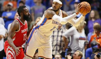 Oklahoma City Thunder forward Carmelo Anthony (7) is guarded by Houston Rockets guard James Harden (13) during the first quarter of an NBA preseason basketball game in Tulsa, Okla., Tuesday, Oct. 3, 2017. (AP Photo/Sue Ogrocki)