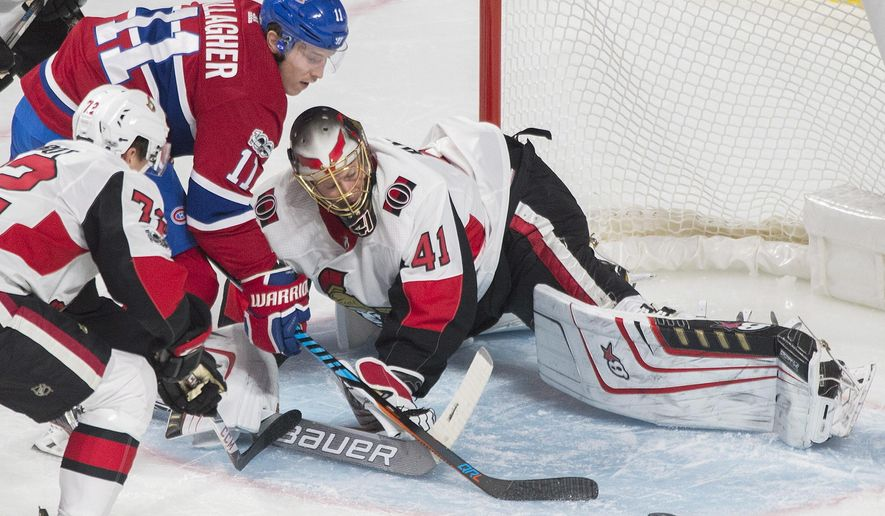 Montreal Canadiens' Brendan Gallagher (11) moves in on Ottawa Senators goaltender Craig Anderson as Senators' Thomas Chabot (72) defends during the second period of an NHL preseason hockey game in Montreal, Saturday, Sept. 30, 2017. (Graham Hughes/The Canadian Press via AP)