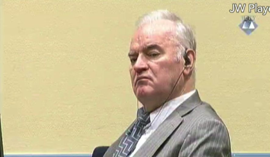 This is a Monday Dec. 5, 2016, file photo taken from video of former Bosnian Serb military chief General Ratko Mladic as he looks across the court room at the International Criminal Tribunal for the Former Yugoslavia in the Hague Netherlands. (ICTY Video via AP File)