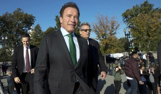 Former California Gov. Arnold Schwarzenegger, arrives at the U.S. Supreme Court in Washington, Tuesday, Oct. 3, 2017. (AP Photo/Manuel Balce Ceneta)
