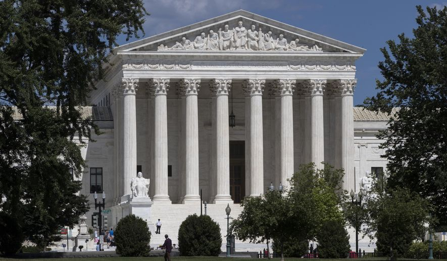 FILE - In this June 26, 2017, file photo, the Supreme Court is seen in Washington. The Supreme Court is taking up a case about political maps in Wisconsin that could affect elections across the country. The justices are hearing argument on Oct. 3 in a dispute between Democratic voters and Wisconsin Republicans who drew maps that have entrenched their control of the legislature in a state that is otherwise closely divided between the parties.  (AP Photo/J. Scott Applewhite, File)