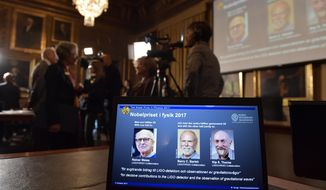 The Royal Swedish Academy of Sciences, announces the 2017 Nobel Prize winners in Physics are pictured on a screen, with from left, Rainer Weiss, Barry C. Barrish and Kip S. Thorne, at the Royal Swedish Academy of Sciences in Stockholm, Sweden Monday Oct. 3, 2017.  (Jessica Gow / TT via AP)