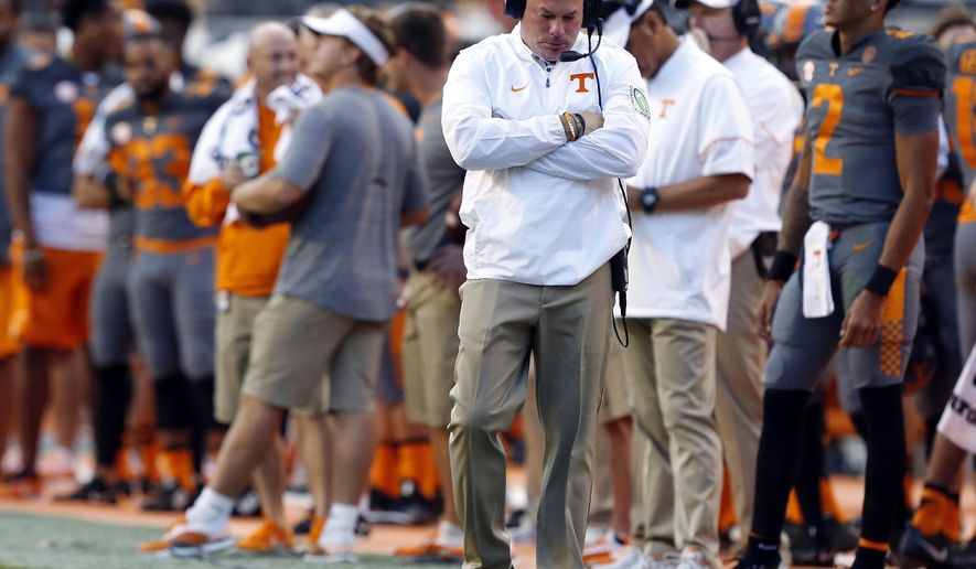 FILE - In this Saturday, Sept. 30, 2017, file photo, Tennessee head coach Butch Jones reacts to a play in the second half of a 41-0 loss to Georgia in an NCAA college football game in Knoxville, Tenn. Tennessee is using its off week to try regrouping following a dispiriting three-week stretch that included its worst home defeat since 1905 and put the heat squarely on embattled coach Jones. (AP Photo/Wade Payne, File)