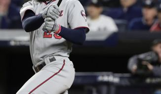 Minnesota Twins' Byron Buxton watches his ground ball on which a runner was forced and a run scored during the third inning of the American League wild-card baseball game against the New York Yankees, Tuesday, Oct. 3, 2017, in New York. (AP Photo/Frank Franklin II)