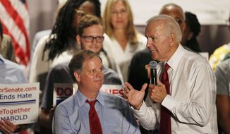 Former Vice President Joe Biden, right, speaks at a rally to campaign for Democrat Doug Jones, left, in the race to fill Attorney General Jeff Sessions' former Senate seat, Tuesday, Oct. 3, 2017, in Birmingham, Ala. (AP Photo/Brynn Anderson)