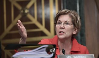 Sen. Elizabeth Warren, D-Mass., questions Wells Fargo Chief Executive Officer and President Timothy Sloan as he testifies before the Senate Committee on Banking, Housing and Urban Affairs on Capitol Hill in Washington, Tuesday, Oct. 3, 2017. (AP Photo/Susan Walsh) ** FILE **