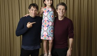"In this Sept. 9, 2017 photo, writer-director Sean Baker, from left, actress Brooklynn Prince and actor Willem Dafoe pose together to promote their film,  ""The Florida Project,"" during the Toronto International Film Festival in Toronto. (Photo by Chris Pizzello/Invision/AP)"