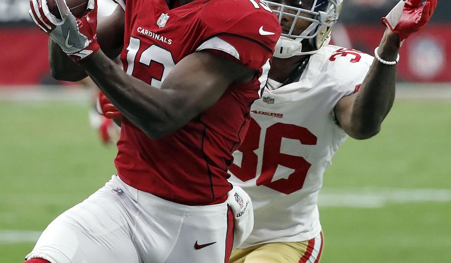 Arizona Cardinals wide receiver Jaron Brown (13) pulls in a catch as San Francisco 49ers cornerback Dontae Johnson (36) defends during the first half of an NFL football game, Sunday, Oct. 1, 2017, in Glendale, Ariz. (AP Photo/Rick Scuteri)