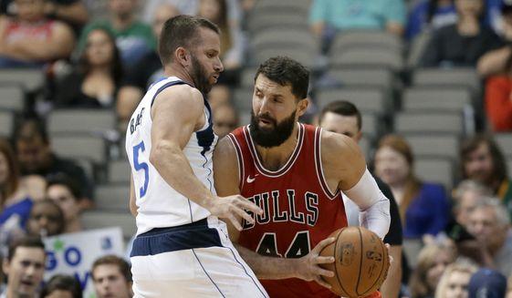 Dallas Mavericks guard J.J. Barea (5) defends Chicago Bulls forward Nikola Mirotic (44) during the second half of a preseason NBA basketball game, Wednesday, Oct. 4, 2017, in Dallas. (AP Photo/Tony Gutierrez) **FILE**